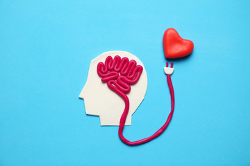 Figure of man with brain and red heart. Love and intelligence. Wall mural