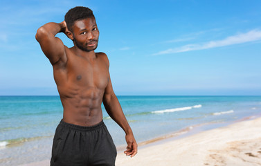 Enjoying healthy lifestyle. Young muscular African man