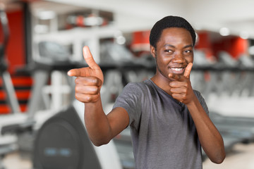 Young african american man pointing copy space