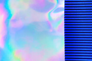 Wall Mural - Abstract Modern holographic background with blue metallized corrugated paper. Synthwave. Vaporwave style. Retrowave, retro futurism, webpunk