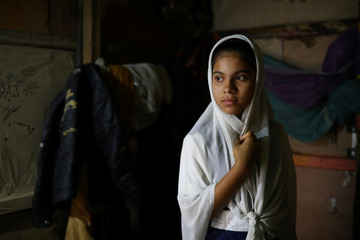 Yasmin, a Rohingya girl who was expelled from Leda High School for being a Rohingya, poses for a picture in Leda camp in Teknaf