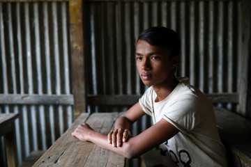 Mohammed Ismail, a Rohingya boy who was expelled from Leda High School for being a Rohingya, poses for a picture in Leda camp in Teknaf