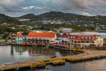 Port of Roatan in the Hondures. Exposure of the Roatan port with its beautiful water, seen from a cruise ship, during morning with heavy clouds in the horizon.