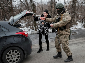 The Wider Image: In shadow of war, Ukrainians seek to vote for peace