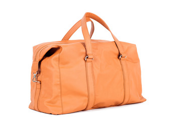 Orange-brown  leather bag for storing things and traveling on a white isolated background. Luggage,...
