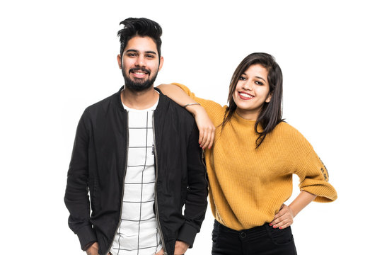 Portrait of beautiful young indian couple smiling isolated on white background