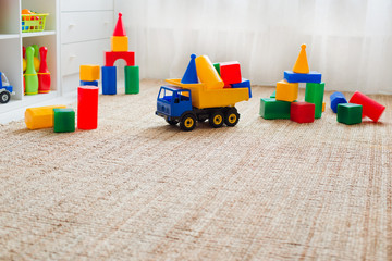 Children's playroom with plastic colorful educational blocks toys.