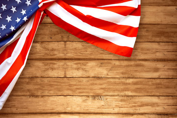 USA Flag folded with wooden background