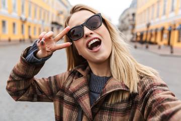 Beautiful young blonde woman wearing a coat
