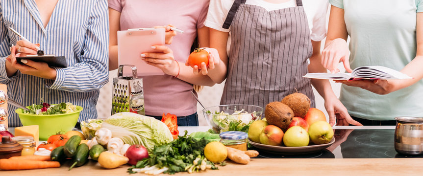 Cooking classes. Food preparing hobby. Group of women learning healthy eating lifestyle and balanced nutrition.
