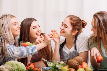 Female cooking classroom. Friendly atmosphere. Healthy eating habit. Dieting together. Food and nutrition tutoring.