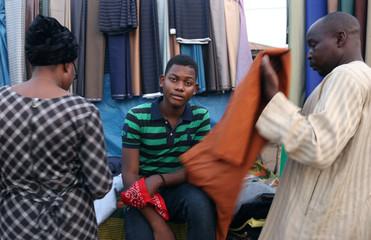 Abdulsalam Zakariyau,19-year-old first time voter, poses at Kulende market in Kwara State