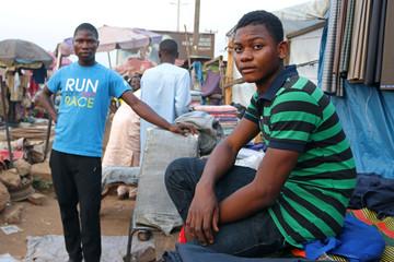 Abdulsalam Zakariyau, 19-year-old first time voter, poses at Kulende market in Kwara State