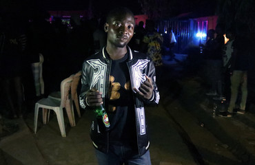 Qudus Ayinla Rasheed, 20-year-old first time voter, poses during a party in Ilorin in Kwara State