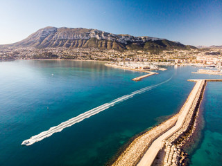 Aerial view of Denia port. The city and Montgo mountain in the background.