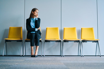 Stressful businesswoman waiting for job interview