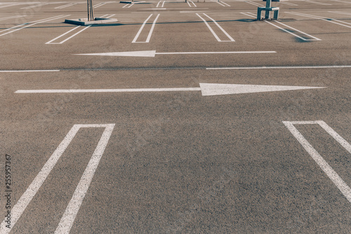Picture of parking lot  Reserve space and arrows pointing