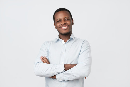 Laughing handsome young african man in shirt smiling confident
