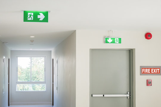 Fire exit sign with light on the path way in the hotel or office
