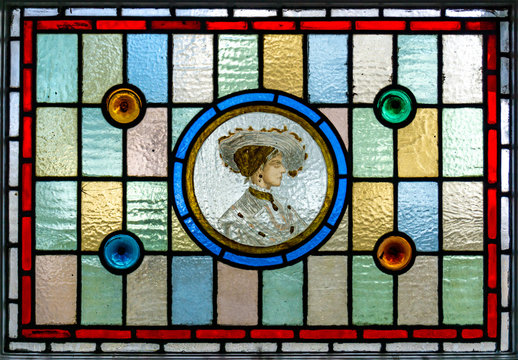 Stained glass window. Portrait of women in stained glass