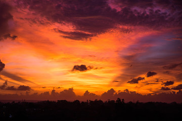 Beautiful sunset with yellow and violet sky at Bali, Indonesia.