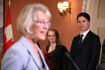 Canada's PM Trudeau and Governor General Payette look on as Joyce Murray is sworn-in during a cabinet shuffle at Rideau Hall in Ottawa