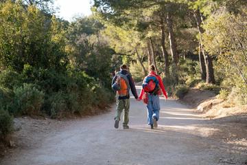 Climbers couple walking on a trail