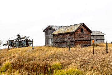 Abondoned farm buildings dot the landscape along HWY 4, Saskatchewan, Canada