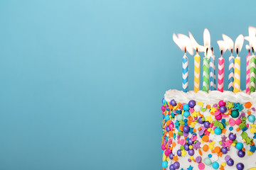 Wall Mural - Colorful birthday cake with lots of candles