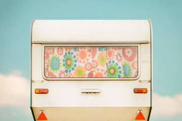 Vintage rear of a caravan with seventies flower curtains