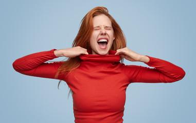 Screaming girl in tight sweater suffering