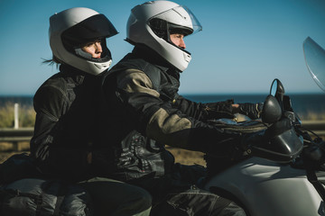 Biker couple in road trip during summer