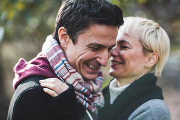 Closeup of smiling mature couple enjoying in winter