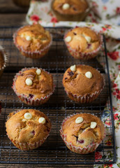 Sweet muffins with raspberries, cranberries and white chocolate chips
