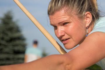 Women playing Novuss in outdoors