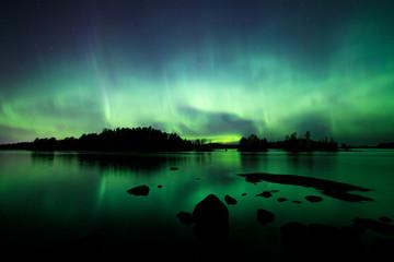 Beautiful northern lights over lake