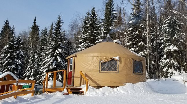 "Cozy Homes/Building Architecture, Called a ""Yurt"",  Shown in a Winter Evergreen Forest on a Clear Day; Tiny Houses, Remote Vacation Ideas"