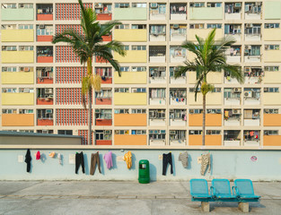 assorted-color clothes hanged on wall near building