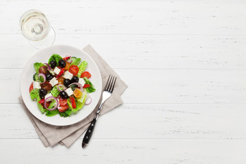 Greek salad plate and white wine