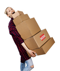 young woman carrying stack of heavy cardboard boxes isolated on white