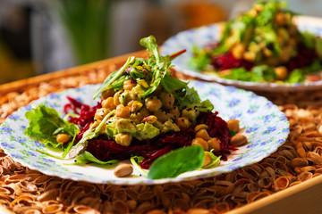 Fresh vegeterian salad on the plates