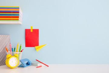 Creative desk full of school accessories. Learning workspace.