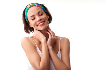 Beautiful young woman portrait with turban style headband while daydreaming