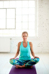 Beautiful mature woman doing yoga