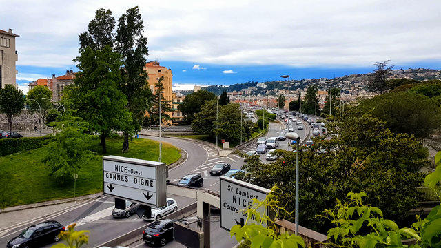 Cars driving on Nice road, city traffic France, ecology problem, air pollution