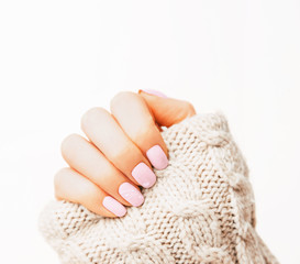 Woman's hand with pink manicure.