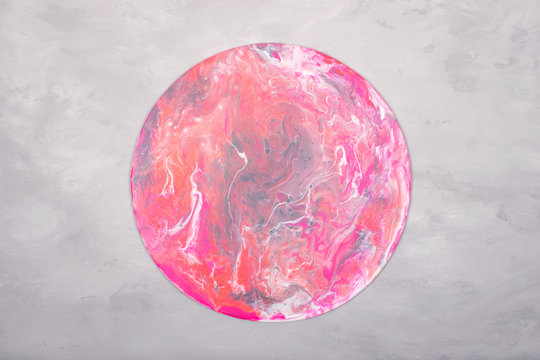 Fluid acrylics art picture. Pouring acrylic paint in pink colors on grey background. Creative artwork.