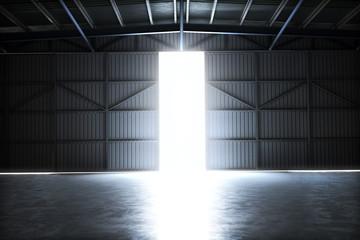 Empty building hangar with the door open with room for text or copy space. 3d rendering interior