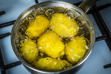 potatoes boil in water and a saucepan. place for your text.