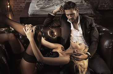 Photo sur Aluminium Artiste KB Handsome businessman relaxing in the luxurious apartment with a sensual woman